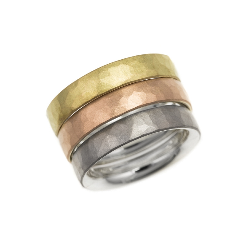 Silver and gold hammered skin rings Photo hannah_webster_sq-3982.jpg