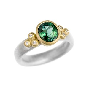 R219 Green tourmaline, diamond, silver and 18ct yellow gold ring