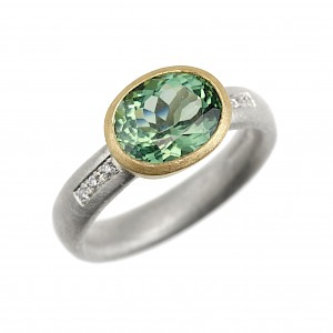 R345 Green tourmaline, diamond, silver and 18ct yellow gold ring